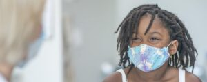 girl with mask at doctor
