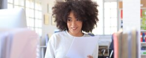 smiling woman with document